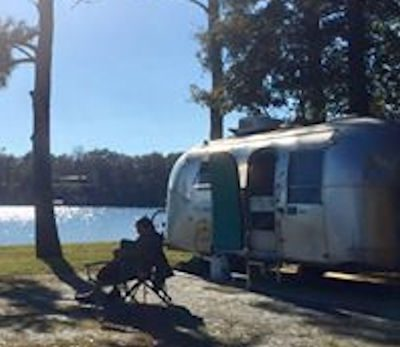 Bobby outside Airstream by Lake