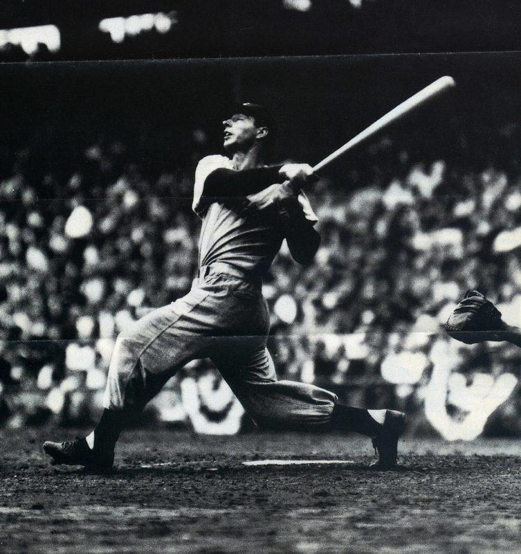 baseball player Joe DiMaggion swinging the bat